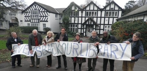 Liberal Democrat councillors and campaigners protest outside the closed Barham Park library