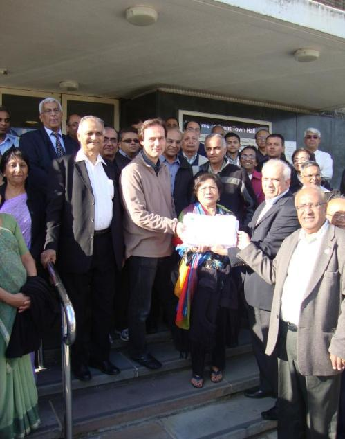 Councillor Paul Lorber and members of the Hindu Council with a petition signed by 6,000 residents