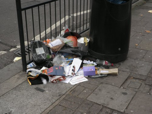 Litter piling up by a litter bin in Brent