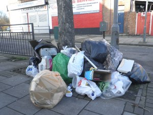 Big pile of bags of rubbish on the pavement