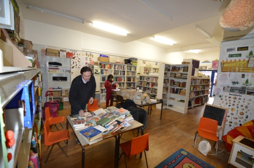 Picture of bookshelves and posters at Barham Volunteer Library