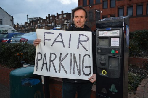 Councillor Pail Lorber next to a parking meter